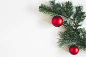 istock Christmas composition. Fir tree branches, red balls on white background. Christmas, winter, new year concept. Flat lay, top view, copy space 1185384542