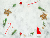 istock Christmas composition. Fir tree branches, snow, red Christmas balls on white concrete background. Christmas, winter, new year concept. Flat lay, top view, copy space. 1264810408