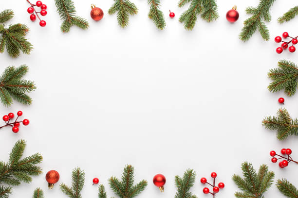 Christmas composition. Frame made of christmas decoration on white background. Flat lay, top view. stock photo