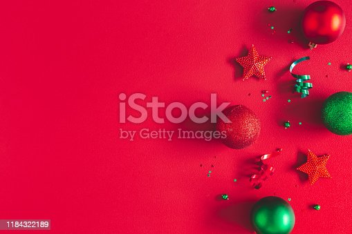 1062680370 istock photo Christmas composition. Frame made of christmas decorations on red background. Flat lay, top view, copy space 1184322189