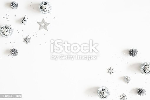 1076057502 istock photo Christmas composition. Frame made of christmas silver decorations on white background. Flat lay, top view, copy space 1184322168