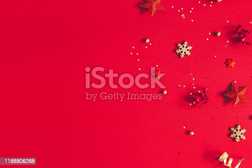 1062680370 istock photo Christmas composition. Frame made of golden decorations on red background. Christmas, winter, new year concept. Flat lay, top view, copy space 1188806268