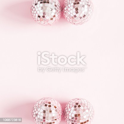 istock Christmas composition. Frame made of pink disco balls on pastel pink background. Christmas, winter, new year concept. Flat lay, top view, copy space, square 1068723816