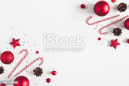istock Christmas composition. Frame made of red decorations on pastel gray background. Christmas, winter, new year concept. Flat lay, top view, copy space 1057149896