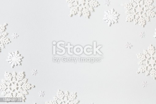 Christmas composition. Frame made of snowflakes on pastel gray background. Christmas, winter, new year concept. Flat lay, top view