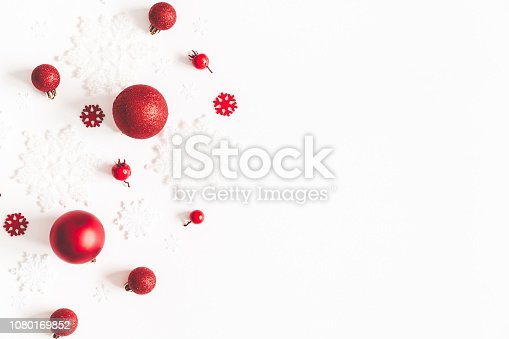 1064023690 istock photo Christmas composition. Frame made of snowflakes, red decorations on white background. Christmas, winter, new year concept. Flat lay, top view, copy space 1080169852