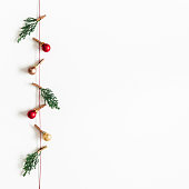 istock Christmas composition. Garland made of red and golden balls, fir tree branches on white background. Christmas, winter, new year concept. Flat lay, top view, copy space, square 1072910756