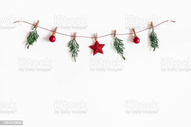 Christmas composition garland made of red balls and fir tree branches picture id1064023690?b=1&k=6&m=1064023690&s=612x612&h=batte9ww2fgovqveho9j rebi28oyhpvhkdwm5hioga=
