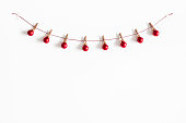 istock Christmas composition. Garland made of red balls on white background. Christmas, winter, new year concept. Flat lay, top view, copy space 1066865974