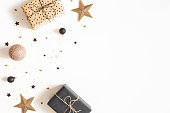 istock Christmas composition. Gift box, beige and black decorations on white background. Christmas, winter, new year concept. Flat lay, top view, copy space 1181173430