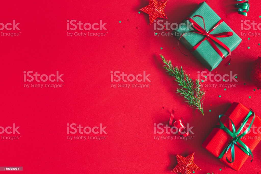Christmas composition. Gift box, christmas decorations on red background. Flat lay, top view, copy space Christmas composition. Gift box, christmas decorations on red background. Flat lay, top view, copy space 2020 Stock Photo
