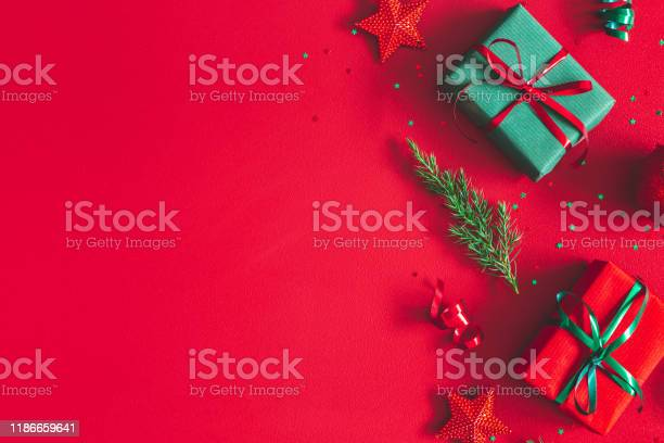 Christmas composition gift box christmas decorations on red flat lay picture id1186659641?b=1&k=6&m=1186659641&s=612x612&h= rhco9 2r rtmcsxuuqvfcqvcn sqaxpm6a31micxho=