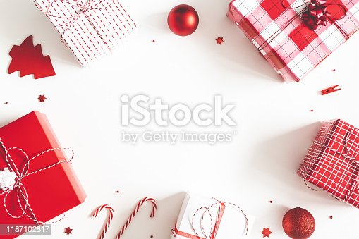 1074095098 istock photo Christmas composition. Gift box, christmas decorations on white background. Flat lay, top view, copy space 1187102817