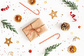 istock Christmas composition. Gift box, fir tree branches, golden decorations on white background. Christmas, winter, new year concept. Flat lay, top view 1183894318