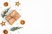 istock Christmas composition. Gift box, fir tree branches, golden decorations on white background. Christmas, winter, new year concept. Flat lay, top view, copy space 1184779828