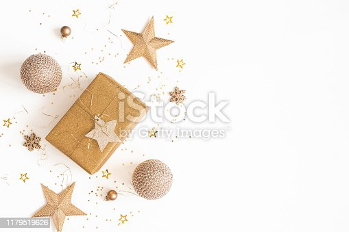 1076055746 istock photo Christmas composition. Gift box, golden decorations on white background. Christmas, winter, new year concept. Flat lay, top view, copy space 1179519626