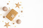 istock Christmas composition. Gift box, golden decorations on white background. Christmas, winter, new year concept. Flat lay, top view, copy space 1179519626