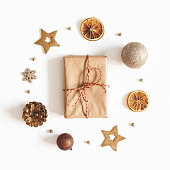 istock Christmas composition. Gift box, golden decorations on white background. Christmas, winter, new year concept. Flat lay, top view 1179521625