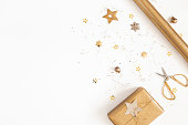 istock Christmas composition. Gift box, golden decorations on white background. Christmas, winter, new year concept. Flat lay, top view, copy space 1180911134