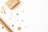 istock Christmas composition. Gift box, golden decorations on white background. Christmas, winter, new year concept. Flat lay, top view 1283451167