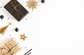 istock Christmas composition. Gift boxes, black and golden decorations on white background. Christmas, winter, new year concept. Flat lay, top view, copy space 1282477070
