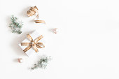 istock Christmas composition. Gift, fir tree branches, balls on white background. Christmas, winter, new year concept. Flat lay, top view, copy space 1074099476