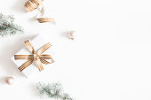 istock Christmas composition. Gift, fir tree branches, balls on white background. Christmas, winter, new year concept. Flat lay, top view, copy space 1075884614