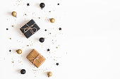 istock Christmas composition. Gifts, black and golden decorations on white background. Christmas, winter, new year concept. Flat lay, top view, copy space 1057151534