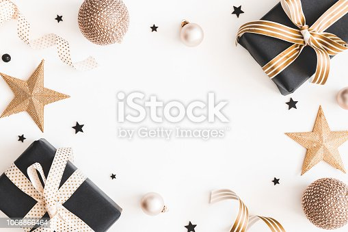 istock Christmas composition. Gifts, black and golden decorations on white background. Christmas, winter, new year concept. Flat lay, top view, copy space 1066866464