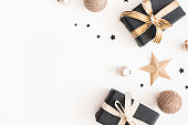 istock Christmas composition. Gifts, black and golden decorations on white background. Christmas, winter, new year concept. Flat lay, top view, copy space 1068723886