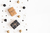 istock Christmas composition. Gifts, black and golden decorations on white background. Christmas, winter, new year concept. Flat lay, top view, copy space 1071429166