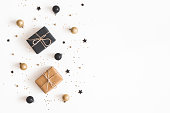 istock Christmas composition. Gifts, black and golden decorations on white background. Christmas, winter, new year concept. Flat lay, top view, copy space 1072910390