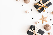 istock Christmas composition. Gifts, black and golden decorations on white background. Christmas, winter, new year concept. Flat lay, top view, copy space 1072912174