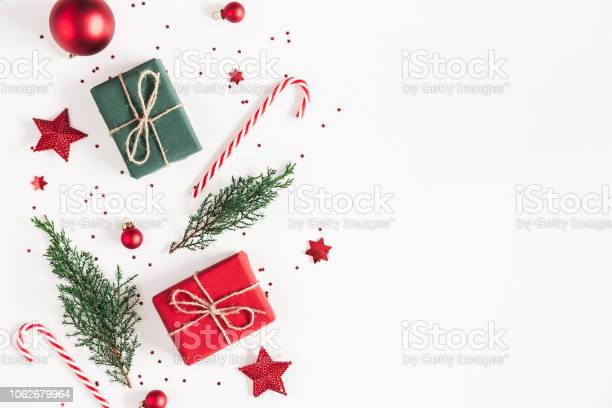 Christmas composition gifts fir tree branches red decorations on picture id1062679964?b=1&k=6&m=1062679964&s=612x612&h=6g adopago2sban4ajx6vazspc51kef gm7ppqlry5m=