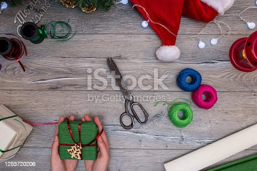1062679964 istock photo Christmas composition. Gifts, fir tree branches, red decorations on white background. Winter, new year concept. stock photo 1253720206