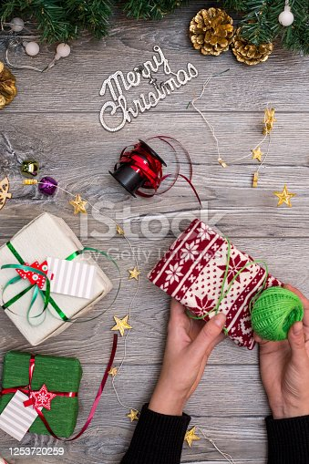 1062679964 istock photo Christmas composition. Gifts, fir tree branches, red decorations on white background. Winter, new year concept. stock photo 1253720259