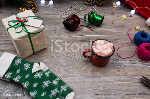 1062679964 istock photo Christmas composition. Gifts, fir tree branches, red decorations on white background. Winter, new year concept. stock photo 1253720280
