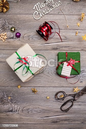 1062679964 istock photo Christmas composition. Gifts, fir tree branches, red decorations on white background. Winter, new year concept. stock photo 1253720308