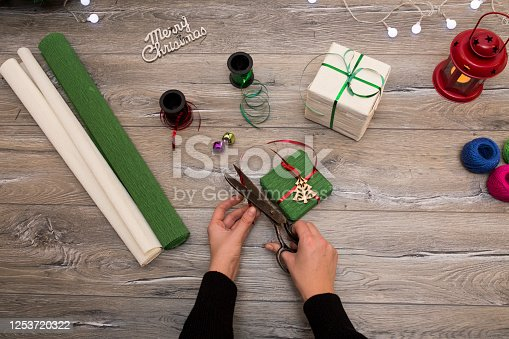1062679964 istock photo Christmas composition. Gifts, fir tree branches, red decorations on white background. Winter, new year concept. stock photo 1253720322