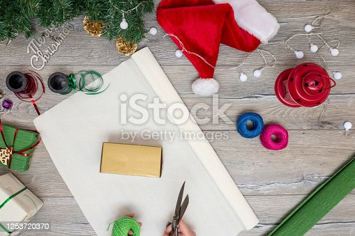 1062679964 istock photo Christmas composition. Gifts, fir tree branches, red decorations on white background. Winter, new year concept. stock photo 1253720370