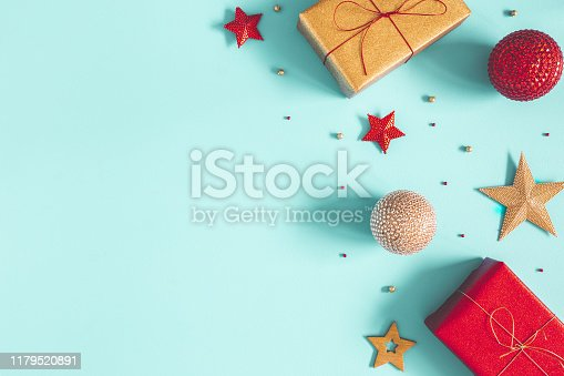 1076063742 istock photo Christmas composition. Gifts, red and golden decorations on blue background. Christmas, winter, new year concept. Flat lay, top view, copy space 1179520891