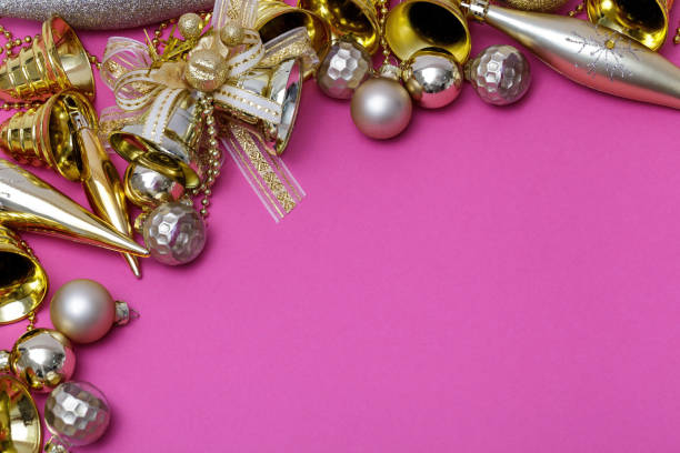 Christmas composition. Gifts, tree branches, golden and silver decorations on pink background. Christmas, winter, new year concept. Flat lay, top view, copy space. stock photo