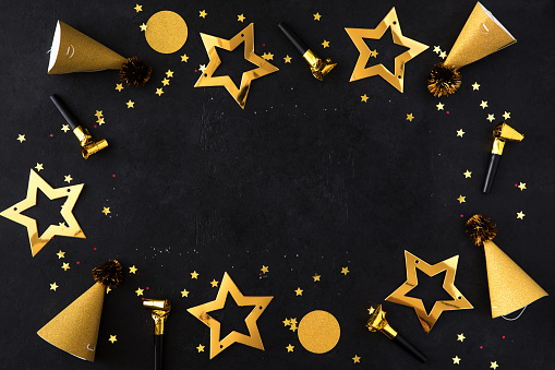 istock Christmas composition. Gold Christmas frame made of balls, golden decorations on black background. Flat lay, top view, copy space 1163534832