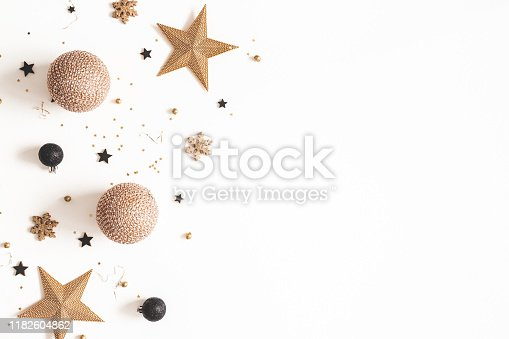 1076057502 istock photo Christmas composition. Golden and black decorations on white background. Christmas, winter, new year concept. Flat lay, top view, copy space 1182604862