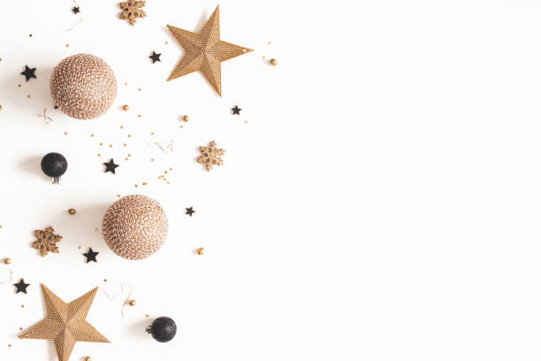 Christmas composition. Golden and black decorations on white background. Christmas, winter, new year concept. Flat lay, top view, copy space stock photo