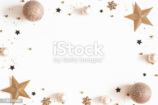 1076057502 istock photo Christmas composition. Golden and black decorations on white background. Christmas, winter, new year concept. Flat lay, top view, copy space 1184780461