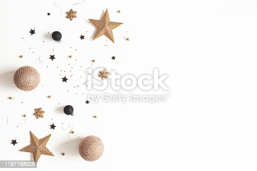 1076057502 istock photo Christmas composition. Golden and black decorations on white background. Christmas, winter, new year concept. Flat lay, top view, copy space 1187788009