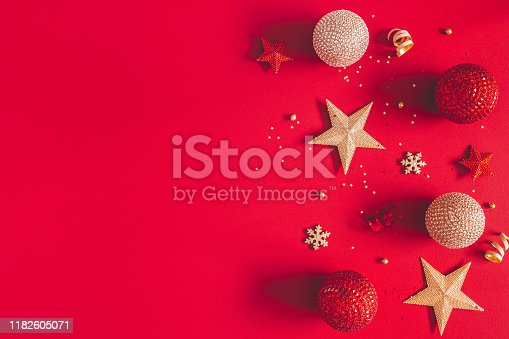 1062680370 istock photo Christmas composition. Golden and red decorations on red background. Christmas, winter, new year concept. Flat lay, top view, copy space 1182605071