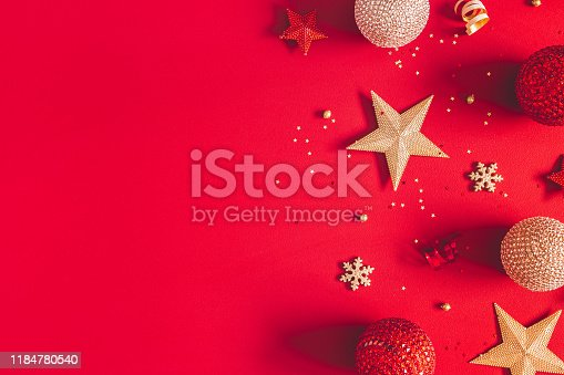 1062680370 istock photo Christmas composition. Golden and red decorations on red background. Christmas, winter, new year concept. Flat lay, top view, copy space 1184780540