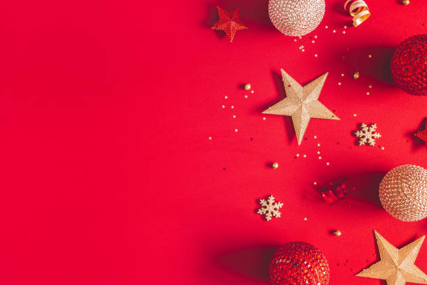 Christmas composition. Golden and red decorations on red background. Christmas, winter, new year concept. Flat lay, top view, copy space stock photo